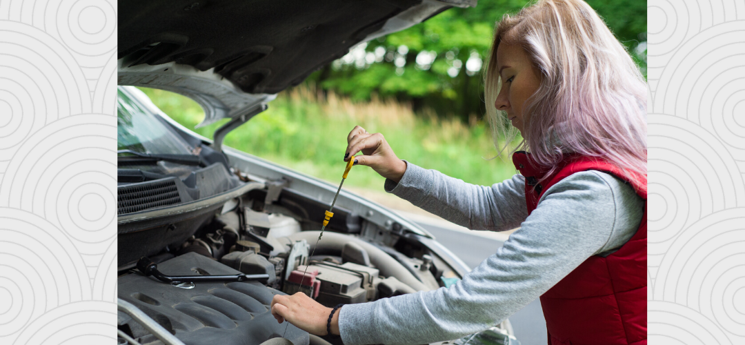 woman checking automotive fluids